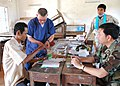 Flickr - Official U.S. Navy Imagery - A Sailor helps Royal Cambodian Armed Forces doctors find the right pair of glasses..jpg