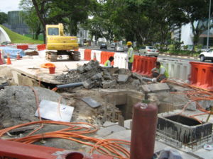 Fort Canning Tunnel - Workers fixing piping at the tunnel entrance