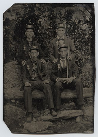Sons of Union Veterans of the Civil War - Four members of the Sons of Veterans, from North Attleboro, Massachusetts, wearing kepis and encampment medals from the Twenty-Fourth National Encampment by the Grand Army of the Republic, in 1890.