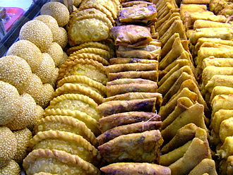 Kue - Indonesian fried snacks, from left to right: kue onde-onde, pastel, martabak mini, risoles. From all those kue only onde-onde are sweet, the rest are savoury.