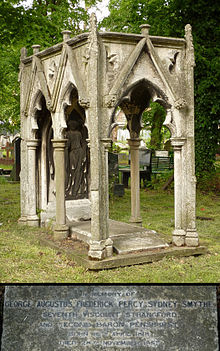 A granite gravestone in the shape of an empty deathbed surmounted by a Gothic-styled six-columned granite canopy