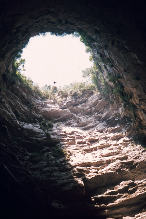 Cave of Swallows - A caver rappels the drop from the cave's mouth