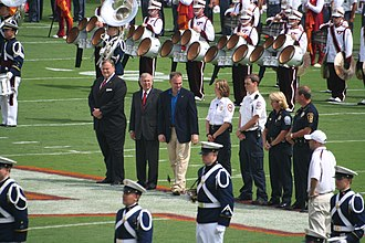 Charles W. Steger - Steger (center left), along with Governor Tim Kaine, thanks the Virginia Tech first responders at the 2007 football season opener