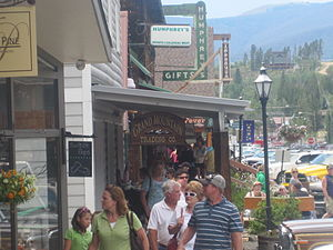 Grand Lake, Colorado - Tourists and customers mingle outside Grand Mountain Trading Company in Grand Lake.