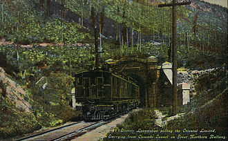 Cascade Tunnel - The Oriental Limited emerging from the old tunnel in 1918. The train was being pulled by an electric locomotive.