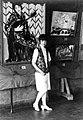 Guan Zilan in front of mandolin paintings.jpg