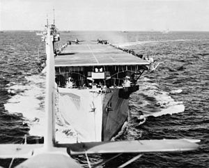 811 Naval Air Squadron - View of HMS Biter from a Swordfish just after take off. Ready on the deck are two Martlet fighters, and in the distance other ships of the convoy, March 1944.