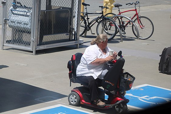 Handicapped boarding at convenient spot on Caltrain.jpg