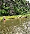 Harvesting rice on the river (7172228009).jpg