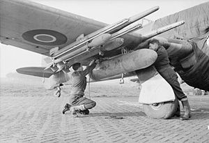 No. 137 Squadron RAF - Crew attaching a long-range fuel tank to a Hawker Typhoon Mark IB of No. 137 Squadron at B78 Eindhoven, the Netherlands