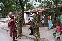 Photograph of Australian members of International Forces East Timor (INTERFET), talking to a citizen in Dili, East Timor in 2000