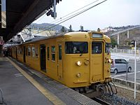 JNR 115 Setouchi yellow livery L-14 set at Seno Station.jpg