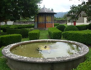 L'Aiguillon - View of the design of the garden in the French Garden. Background right is a miniature house.