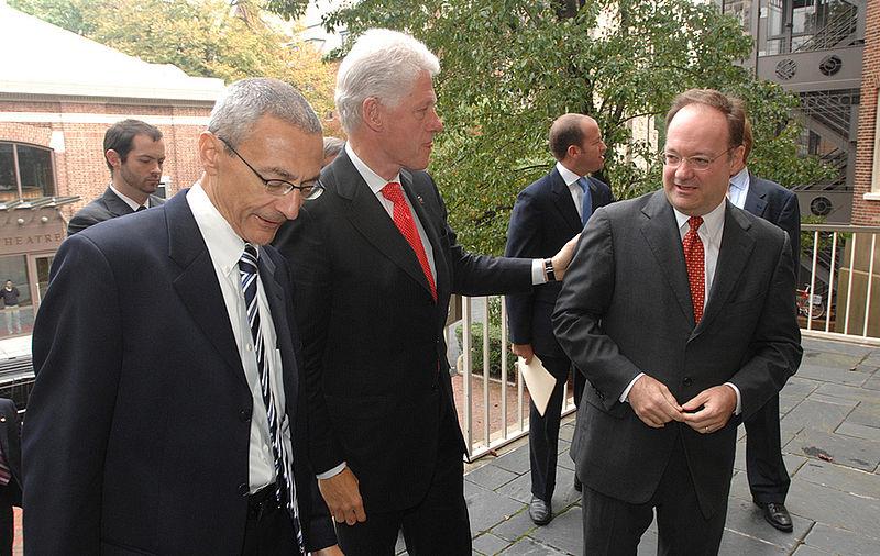 John Podesta, Bill Clinton, and John DeGioia.jpg
