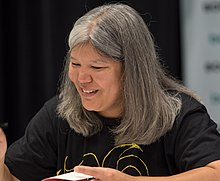 Kagawa autographing a book at BookExpo America in 2018