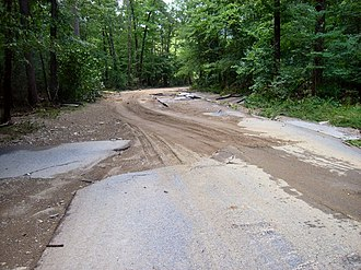 2010 Arkansas floods - The force of water stripped the pavement from this road.
