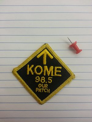 KOME - One of the yellow-on-black editions of the patch, with pushpin for size comparison.