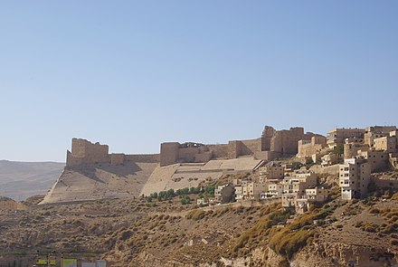 The Karak Castle (c. 12th century AD) built by the Crusaders, and later expanded under the Muslim Ayyubids and Mamluks. Kerak BW 1 (cropped).JPG
