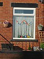 Knitted COVID 19 Rainbow Dolls window.jpg