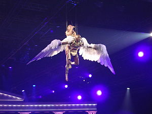 "Aphrodite (album) - Minogue performing ""Closer"" during the Aphrodite: Les Folies Tour."
