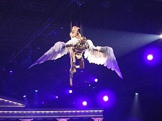 """Aphrodite (album) - Minogue performing """"Closer"""" during the Aphrodite: Les Folies Tour."""
