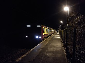 IBM railway station - 314216 arrives at IBM on 8 December 2018 forming the 23:48 service to Glasgow Central. This was the last passenger service to stop at the station