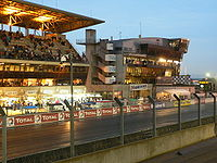 The pits of Le Mans at dawn.