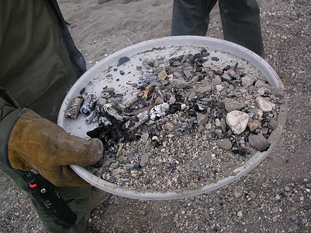 A demonstration of a Leave No Trace fire in a fire pan. Leave No Trace Fire.jpg