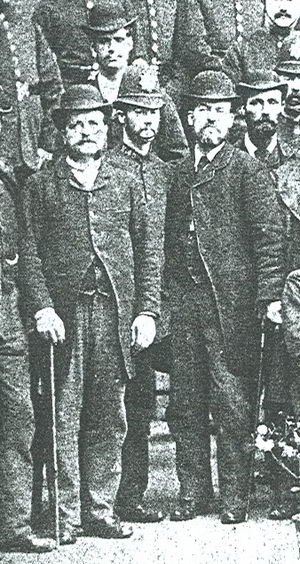 Detective - H Division, of police detectives, including Frederick Abberline (left, with cane), at Leman Street police station, of the London Metropolitan Police, two years before the Jack the Ripper serial killer murders of 1888.  Photograph circa 1886
