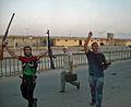 Les rebelles entrent dans lenceinte residentielle de Kadhafi (6080516206).jpg