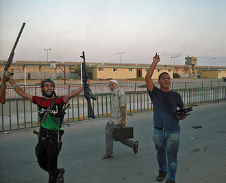 Bab al-Azizia - Rebels cheer as they occupy Gaddafi's HQ in August 2011.