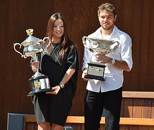 2014 Australian Open - Li Na and Stan Wawrinka photographed at the 2015 Australian Open with the trophies they won in 2014.