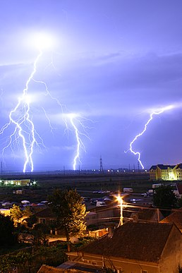 Lightning is the electric breakdown of air by strong electric fields. Heat and light from a lightning produces a plasm motion of air molecules.