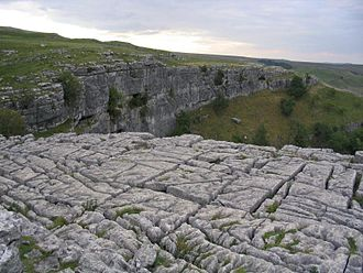 Geology of England - Limestone pavement above Malham Cove in part of the Yorkshire Dales formed of Carboniferous limestone
