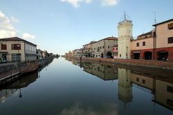 Loreo: the channel of Loreo (Canale di Loreo) and, on the right, the civic bell tower