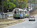 MBTA 3680 passing Greycliff Road station site, October 2016.JPG