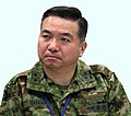 Maj. Gen. Koichiro Bansho, Chief, Bilateral Crisis Action Team, receives a daily rescue operations update brief after the earthquake, -26 Mar. 2012 a.jpg