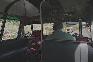 Intercity bus driver - An intercity bus driver driving a bus