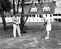 Man and woman putting on the gold course at Big Four Inn, near Monte Cristo, Snohomish County, Washington, ca 1923 (WASTATE 702).jpeg