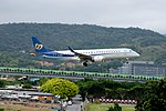 Mandarin Airlines Embraer ERJ 190 B-16825 on Final Approach at Taipei Songshan Airport 20150321b.jpg