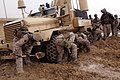 Marines freeing Cougar vehicle with shovels.jpg