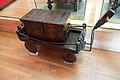 Medieval strongbox on cart (39816818205).jpg