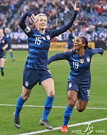 Rapinoe celebrates a goal with teammate Crystal Dunn, 2019
