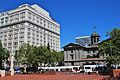 Meier & Frank Building with Pioneer Courthouse, bus and MAX.jpg