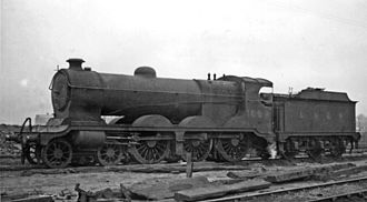 GCR Class 8 - Ex-Great Central 'Fish' class 4-6-0 at Mexborough Locomotive Depot. LNER Class B5 No. 1689 was one of the earlier Robinson 4-6-0s, built February 1904, became LNER No. 5186 and was withdrawn in October 1949, six months after this photograph. It looks ready to retire, having been relegated to banking up to Dunford Bridge following exhausting work during the war: here it is still in—extremely dirty—LNER livery.