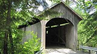 Mill Covered Bridge (Belvidere, Vermont) wooden covered bridge that crosses the Lamoille River in Belvidere, Vermont on Back Road