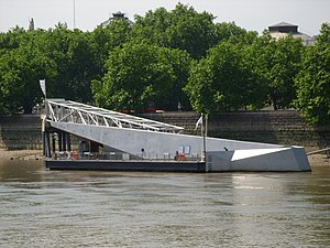 Millbank Pier immediately outside Tate Britain. High speed boats link the pier to Tate Modern. The structure is intended to resemble a shark rising from the water.