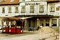 Minol Tankstelle with former Hotel Thüringer Hof, Gotha DDR, Aug 1989 (2881313193).jpg