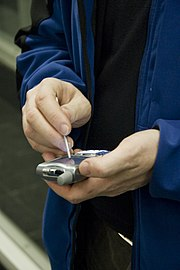 User with Treo (PDA with smartphone functionality)