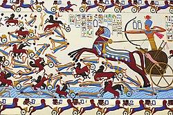 photographie représentant le pharaon Ahmôsis Ier monté sur son char de guerre combattant les Hyksos
